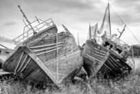 35 – Lampedusa. Telles des baleines échouées, les carcasses des navires, après avoir accompli leurs tâches, se reposent dans l'attente de leurs dépeçages.